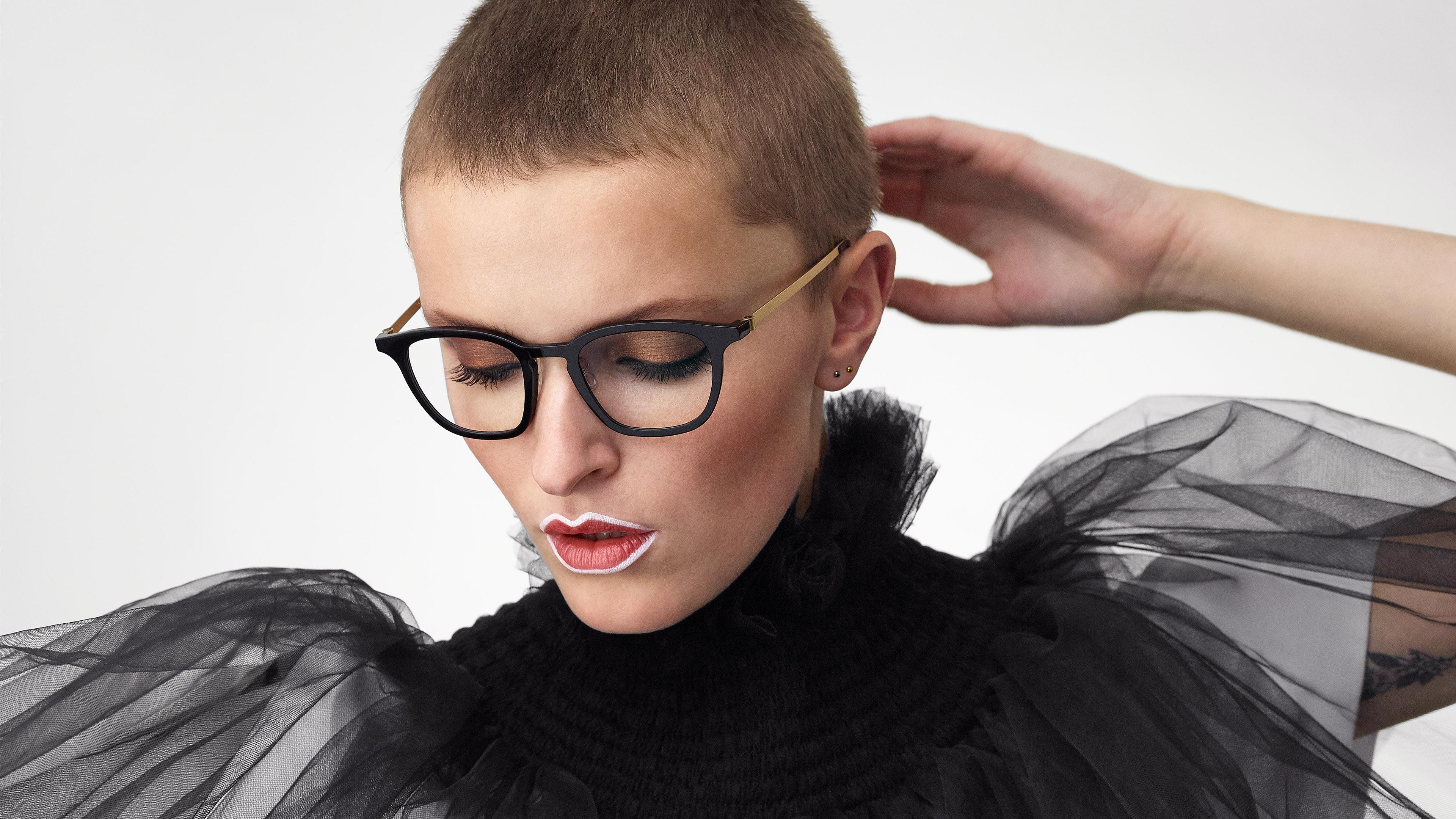 LINDBERG acetanium Model 1047 black acetate and gold titanium glasses in a women's panto shape
